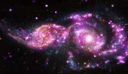1.3億光年外星系互相碰撞:絢爛似太空煙火秀
